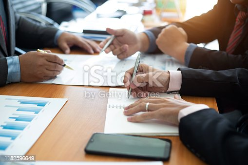 istock Closeup hand team business analysts make decisions about the US economy that affect future operations of the company.concept 1182596649