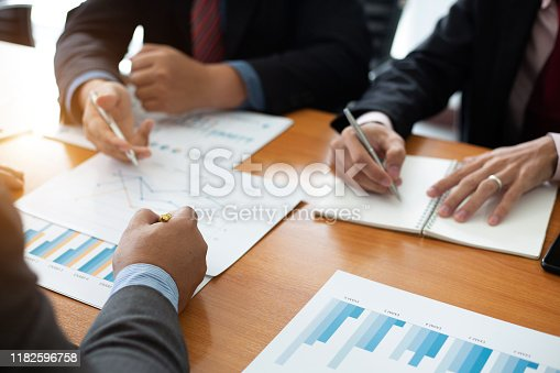 istock Closeup hand team business analysts make decisions about the US economy that affect future operations of the company.concept 1182596758
