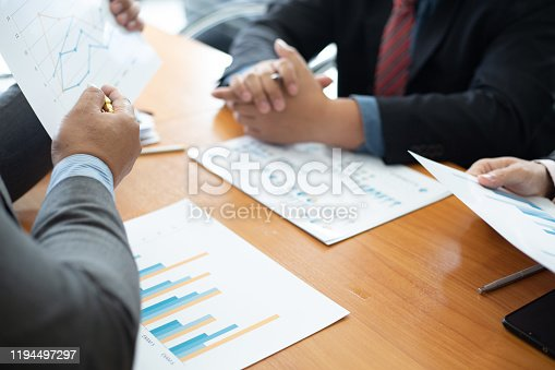 istock Closeup hand team business analysts make decisions about the US economy that affect future operations of the company.concept 1194497297