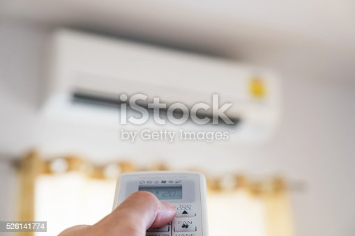 istock Close-up hand using remote control of air condition, selective focus 526141774