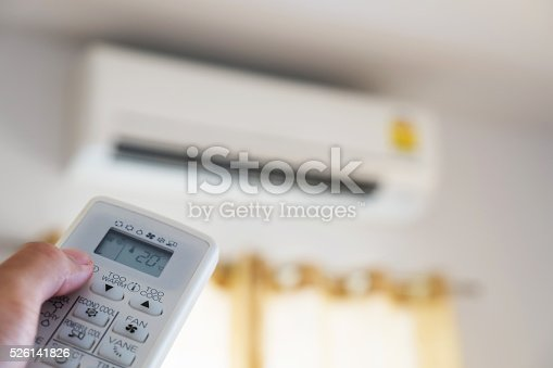 istock Close-up hand using remote control of air condition, selective focus 526141826
