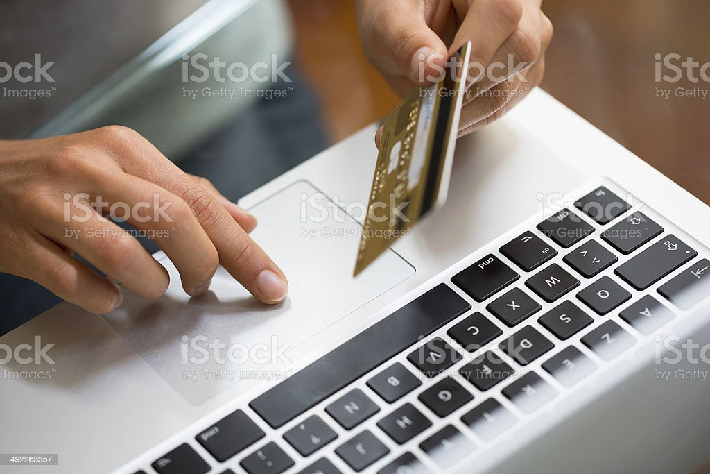 Close-up hand woman using laptop and credit card, online shopping stock photo