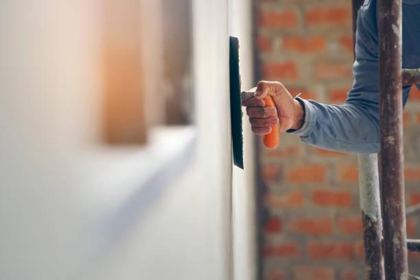 close-up hand, worker, concrete plaster - gips materiał budowlany zdjęcia i obrazy z banku zdjęć