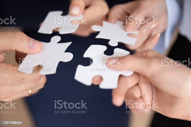 Closeup hands holding white pieces of puzzles find right solution picture id1257268424?b=1&k=6&m=1257268424&s=612x612&h=uxm efcfsqotqjwtvowgkbeqsscwkv vmnmdu4ztcx8=