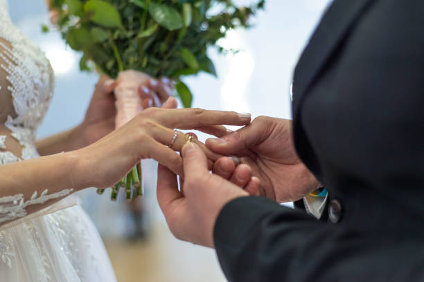 https://media.istockphoto.com/photos/closeup-hands-of-a-bride-and-groom-exchanging-wedding-rings-on-a-day-picture-id1219012202?k=6&m=1219012202&s=612x612&w=0&h=X5dTI3vV-QUv8NVX2JE2CPt6FsogDDaJ9Mb50-qAKpA=
