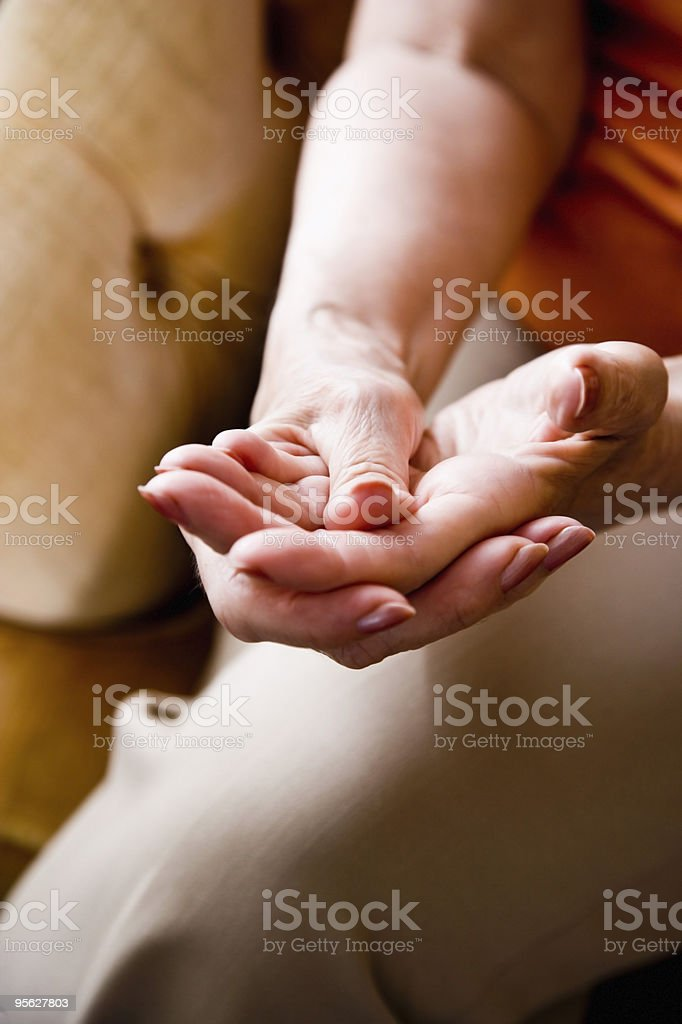Close-up hands of elderly woman stock photo