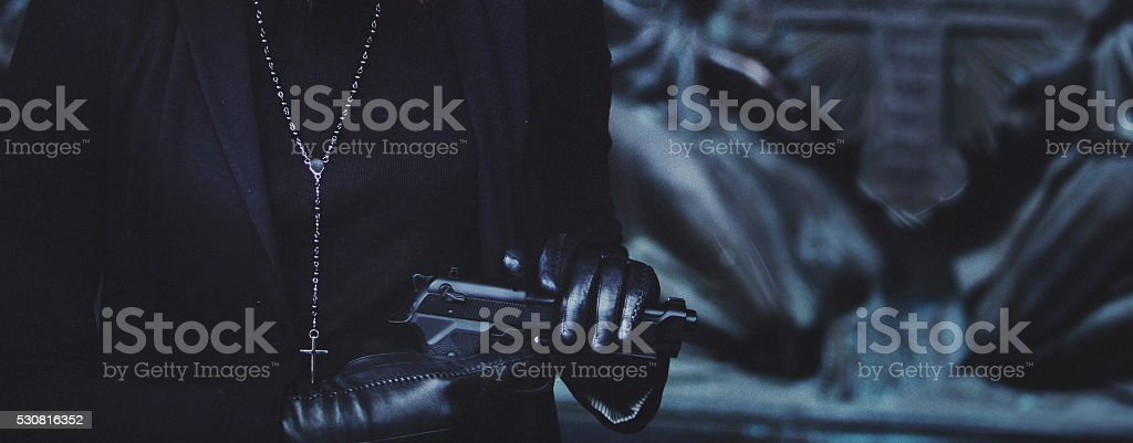 close-up hands of girls in black leather gloves, grip stock photo