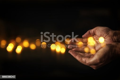 istock closeup hands of man begging for help. concept for poverty or hunger, seeking for light in the dark. 886098042