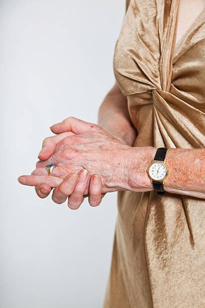 Closeup hands of senior woman stock photo