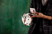 istock Close-up hands of young man with gambling cards 1283737848