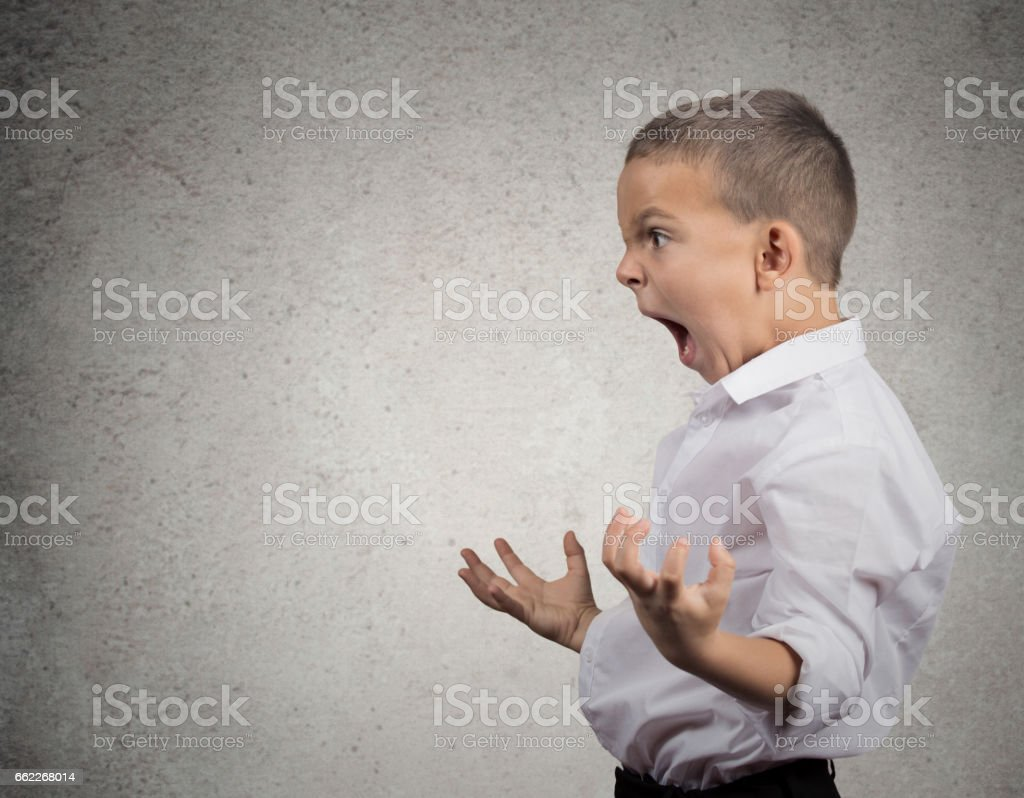 Closeup Headshot side view Portrait Angry Child Screaming stock photo