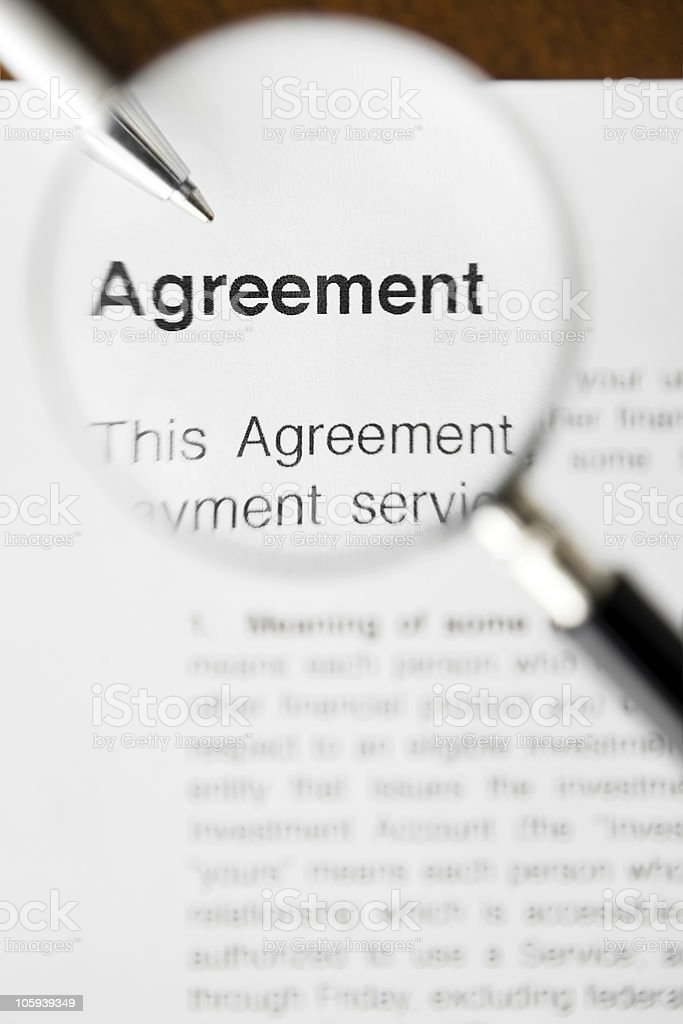 Close-up, high-angle view magnifier and agreement stock photo