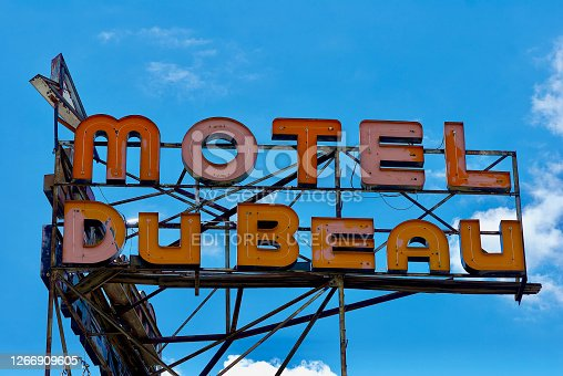 Flagstaff, Arizona / USA - July 25, 2020: Closeup of the large neon sign advertising the Motel Du Beau to travelers on historic Route 66 in the heart of Flagstaff.