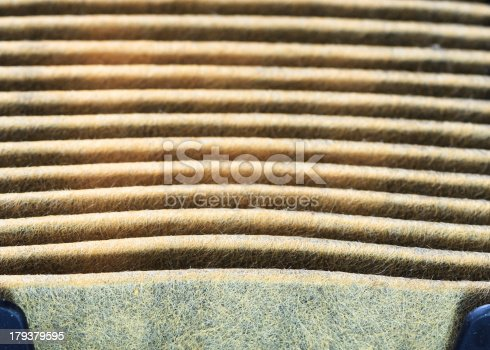 istock Closeup Horizontal Grooves of Used Air Filters showing Material Textures 179379595