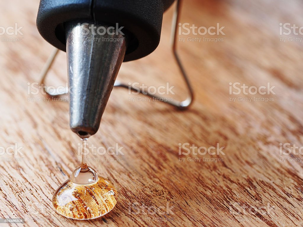 closeup hot glue gun with melted glue dripping out stock photo