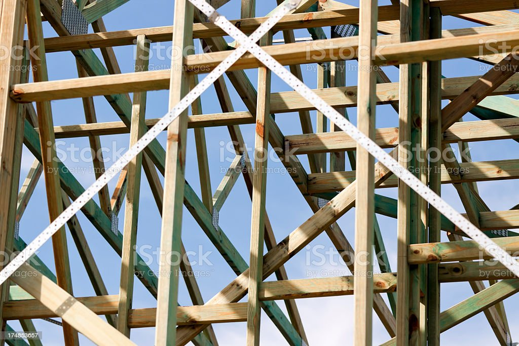 Closeup house wooden construction frame against blue sky royalty-free stock photo