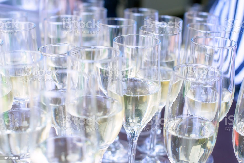 Close-up iced champagne or sparkling wine in glass flutes on a table in a restaurant ready for an extravaganza, celebration or a party royalty-free stock photo
