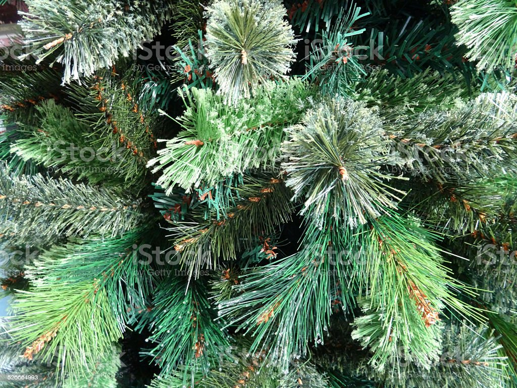 close up image artificial christmas tree foliage frosted with fake snow royalty free