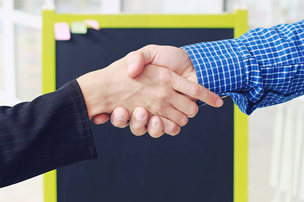 Close-up image handshake standing for a trusted partnership . stock photo