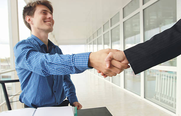 Close-up image handshake standing for a trusted partnership stock photo