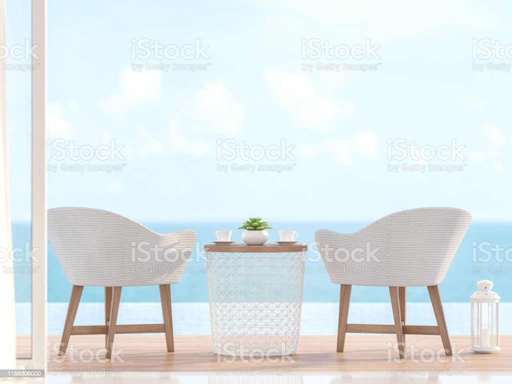Closeup image of 2 white chairs with blurry sea view 3d render Closeup image of 2 white chairs with wooden legs Located on the pool terrace With a blurred sea background image - 3d render Architecture Stock Photo