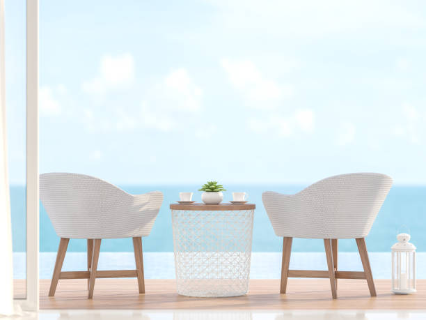 Closeup image of 2 white chairs with blurry sea view 3d render stock photo