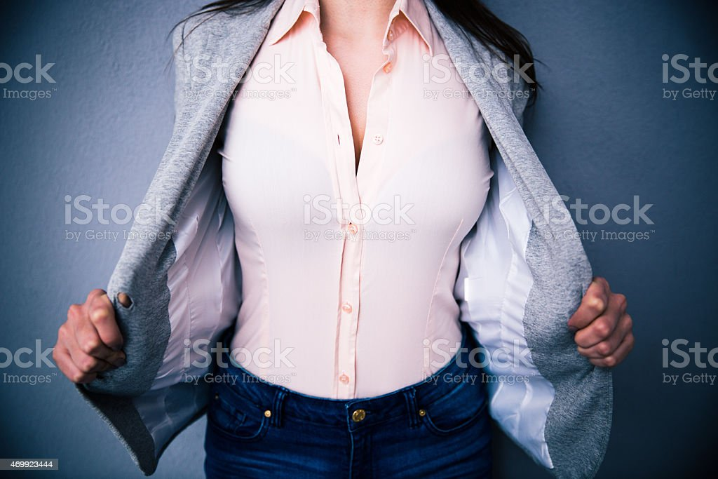 Closeup image of a Businesswoman showing her breasts stock photo