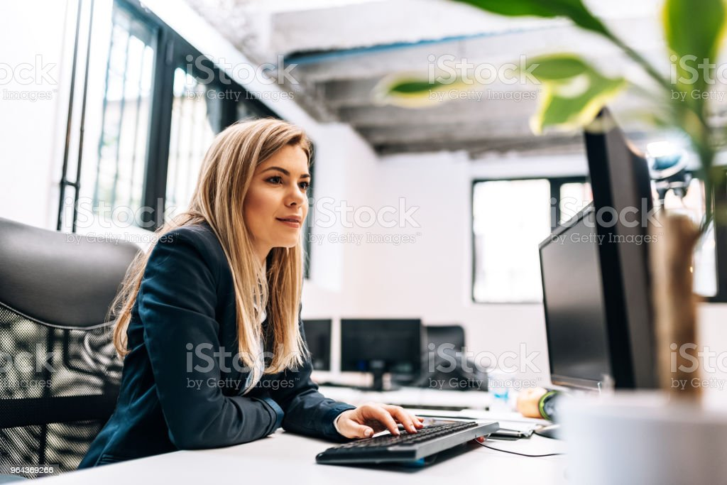 Close-up image of a businesswoman working on the computer. stock photo