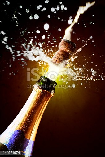 istock A close-up image of a champagne bottle being popped 144971074