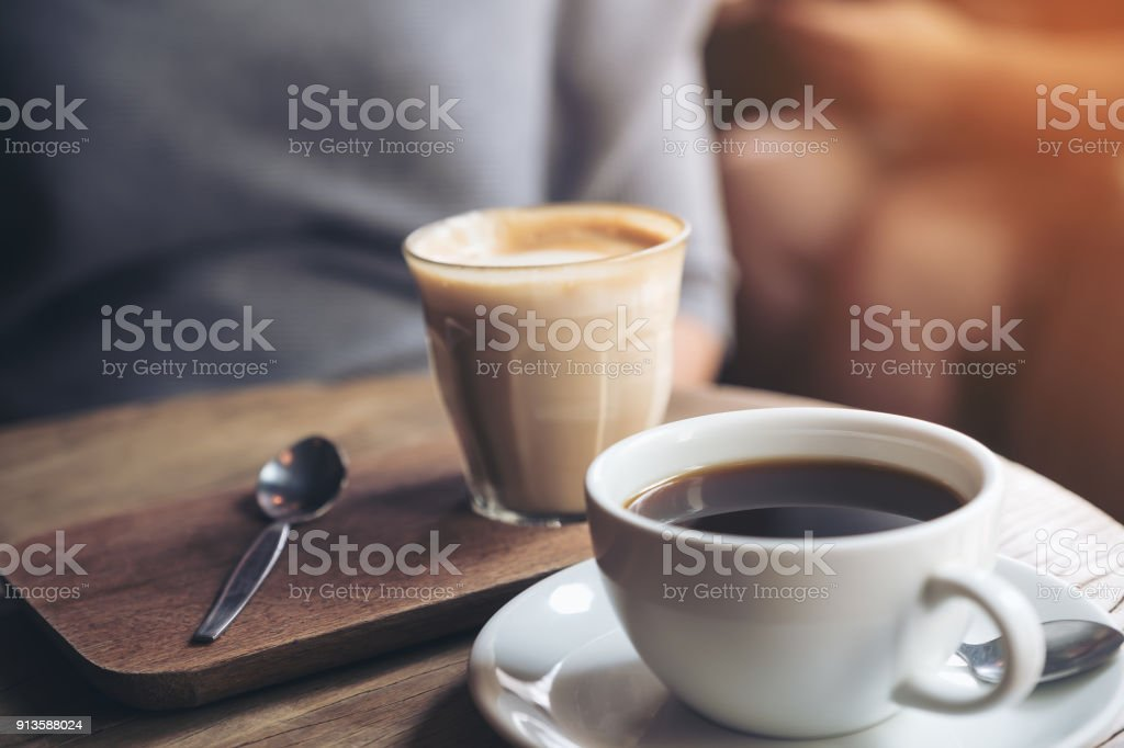 Closeup Image Of A Cup Of Americano Coffee And A Glass Of Latte Coffee On Vintage Wooden Table In Cafe Stock Photo Download Image Now Istock