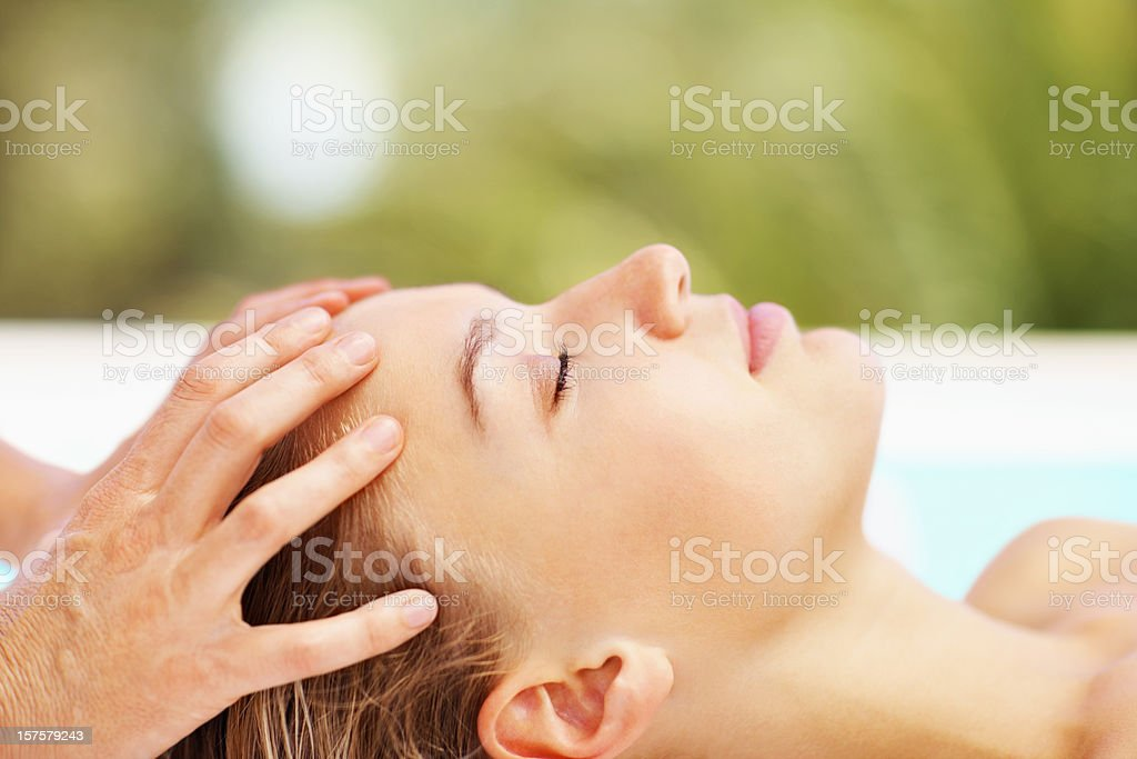 Closeup image of a female receiving head massage royalty-free stock photo