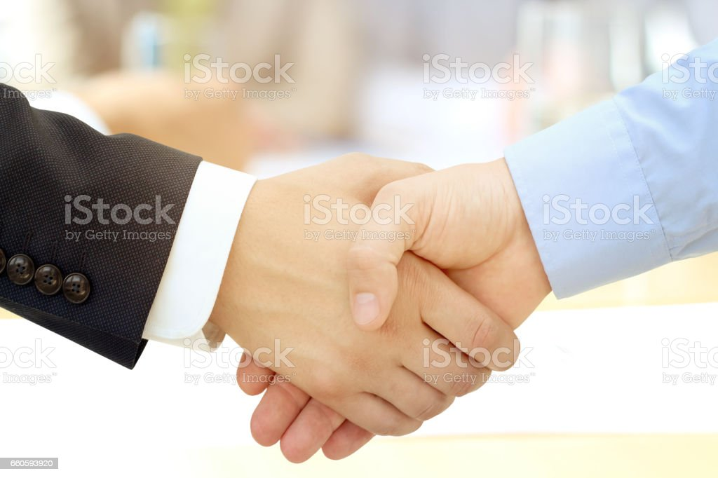 Close-up image of a firm handshake between two colleagues royalty-free stock photo