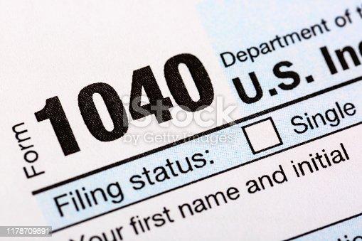 istock Closeup image of blank american 1040 Individual Income Tax return form. 1178709891