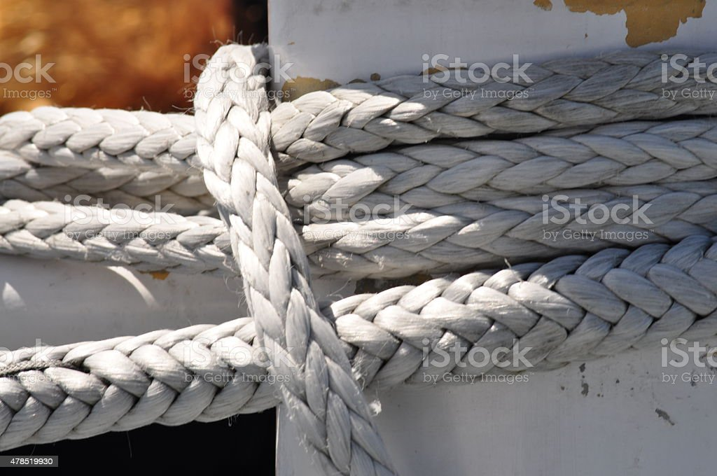 Close-Up Image of Braided Rope on Sea Vessel stock photo