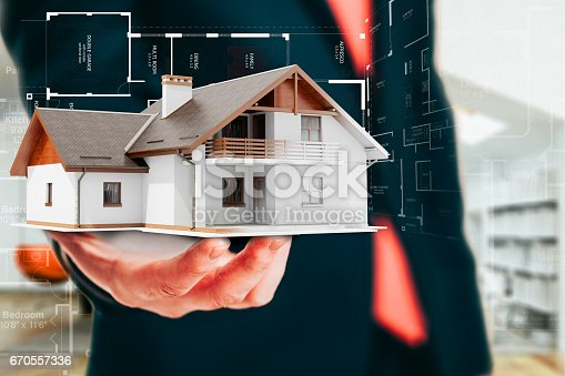 istock Close-up image of businessman holding a 3d house, architecture project 670557336
