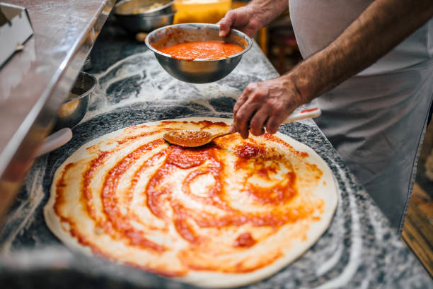 Close-up image of chef making pizza. stock photo