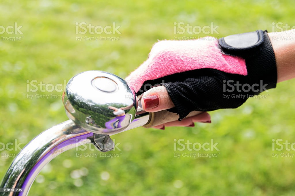 Close-up image of cyclist woman riding bike on trail in summer stock photo