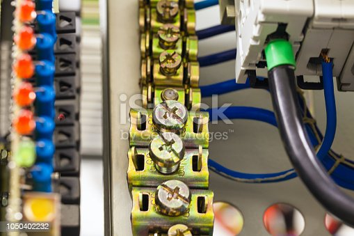 istock Close-up image of electrical wires is connected to cuprum clamps in power system of direct voltage with electrical circuit breakers for communication equipment 1050402232
