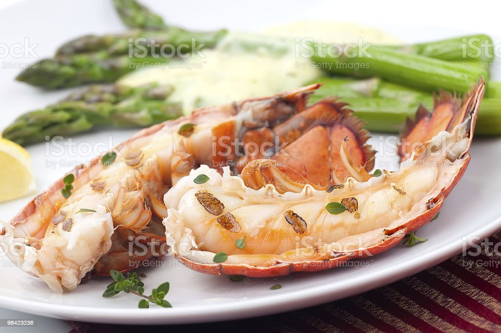 Close-up image of grilled lobster tails carefully plated royalty-free stock photo