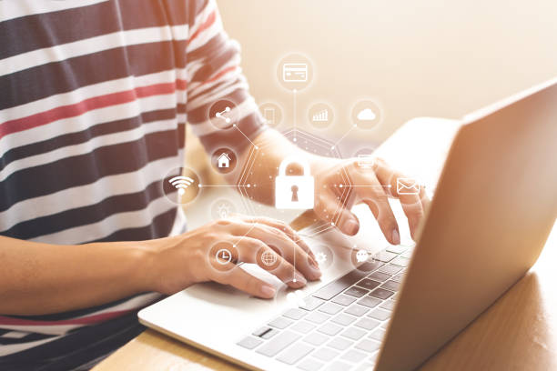 Close-up image of male hands using computer laptop with icon graphic cyber security network of connected devices and personal data information Close-up image of male hands using computer laptop with icon graphic cyber security network of connected devices and personal data information identity theft stock pictures, royalty-free photos & images