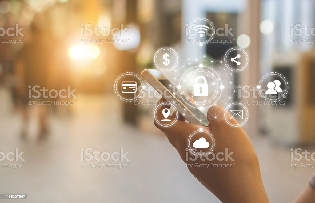 Close-up image of male hands using mobile smartphone with icon graphic cyber security network of connected devices and personal data information Close-up image of male hands using mobile smartphone with icon graphic cyber security network of connected devices and personal data information Accessibility Stock Photo