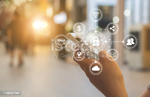 istock Close-up image of male hands using mobile smartphone with icon graphic cyber security network of connected devices and personal data information 1158337567