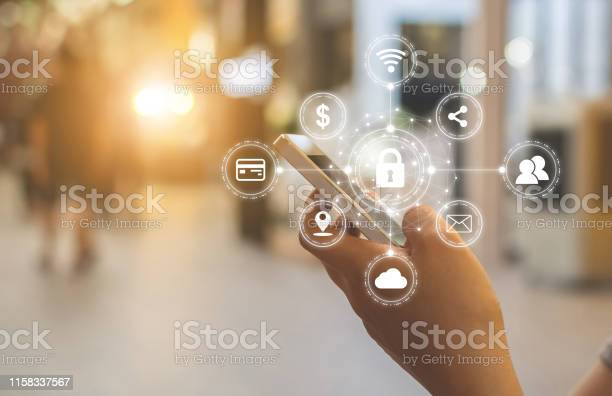 Closeup Image Of Male Hands Using Mobile Smartphone With Icon Graphic Cyber Security Network Of Connected Devices And Personal Data Information Stock Photo - Download Image Now