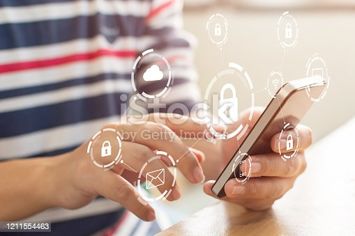 1068838170 istock photo Close-up image of male hands using mobile smartphone with icon graphic cyber security network of connected devices and personal data information 1211554463