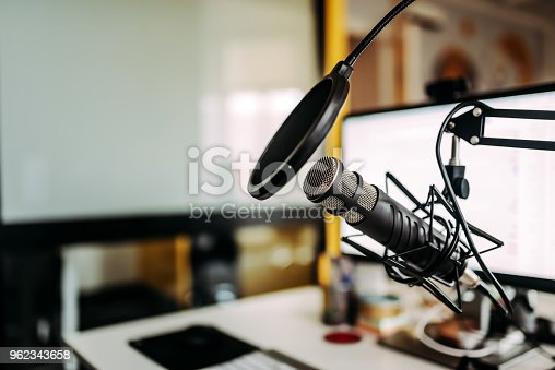 istock Close-up image of microphone in podcast studio. 962343658