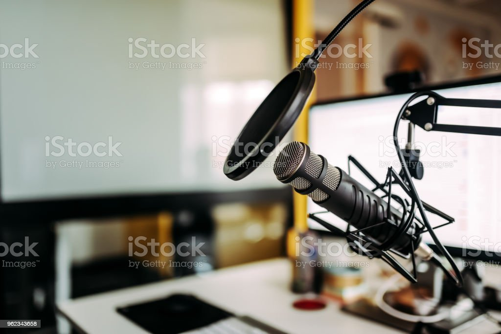 Close-up image of microphone in podcast studio. stock photo