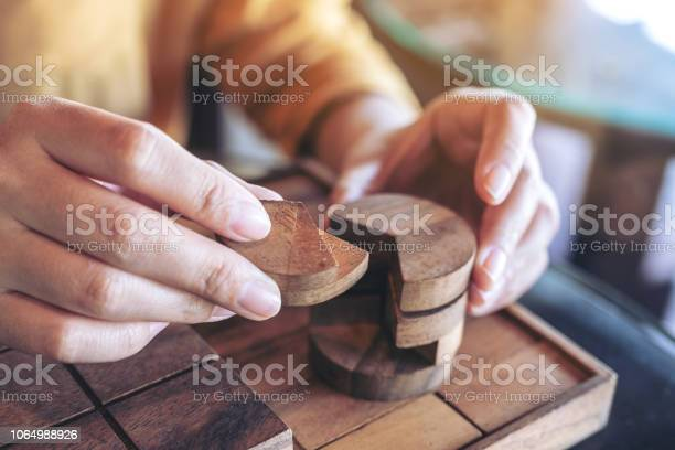 Closeup image of people playing and building round wooden puzzle game picture id1064988926?b=1&k=6&m=1064988926&s=612x612&h=q2fliwr5pd73jbod0aezbltfzbzbkvrycyrfu0wnhv4=