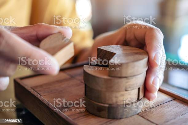 Closeup image of people playing and building round wooden puzzle game picture id1066986782?b=1&k=6&m=1066986782&s=612x612&h=o4cgitiyrtmhenpwfexmeb4ximn7kfsnuwac fu9pd0=