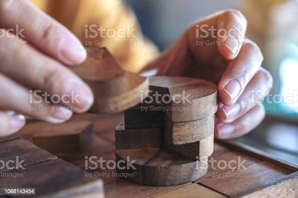 Closeup image of people playing and building round wooden puzzle game picture id1068143454?b=1&k=6&m=1068143454&s=612x612&h=o9 topuyhybo8egabzpsk f7v y5zp2tspyv4offi1g=