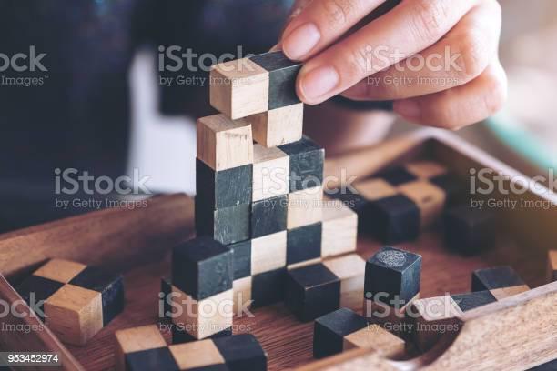 Closeup image of people playing and building wooden puzzle game picture id953452974?b=1&k=6&m=953452974&s=612x612&h=otxu70xsesdjokud tgjxtgl8b9rtnrcrrl0xh2c5ew=